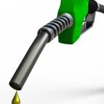 Green fuel nozzle with golden droplet on white background